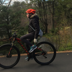 girl with diabetes rides her bike with no hands