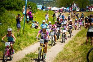Little Bellas ride through crowds cheering at Beti Bike Bash