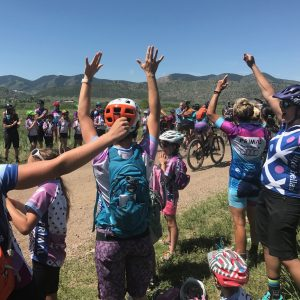 women on sidelines at Beti Bike Bash cheering