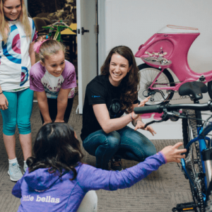 Sabra Davison checks out the Specialized Pitch 650b Little Bellas edition with a group of Little Bellas