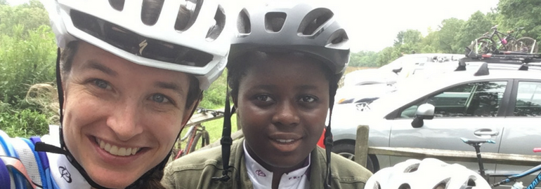 Executive Director, Sabra Davison, and a young girl, Awo, who she taught to ride a bike
