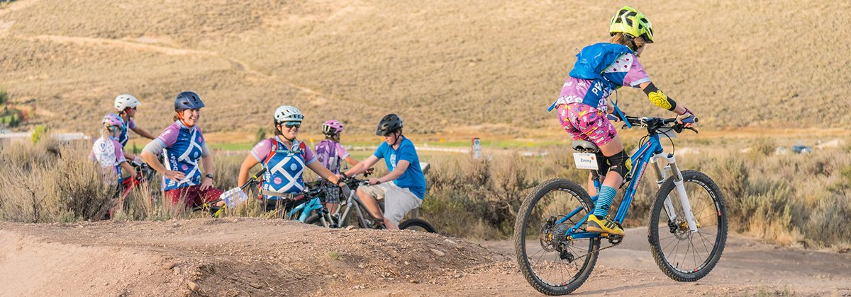 girl riding a pump track