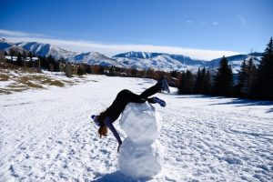 Julia Kern on top of a snowman