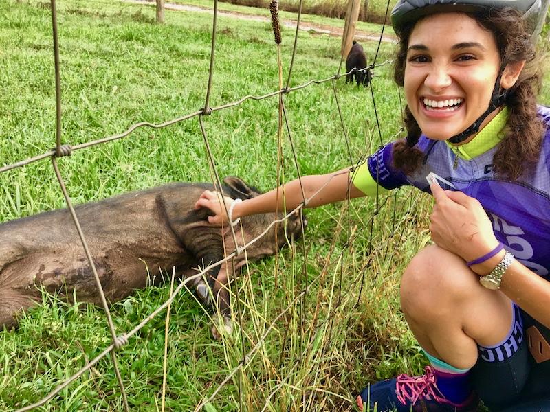 Little Bellas Athens lead Jade Fernandez pets a pig