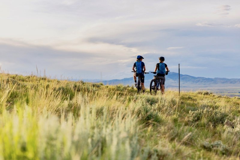 Two mountain bikers taking in the expansive Wyoming landscape