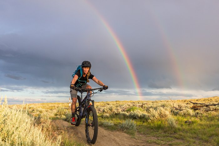 New Little Bellas program lead, Nyla Hurley, chased by a pair of rainbows in Cody, Wyoming.
